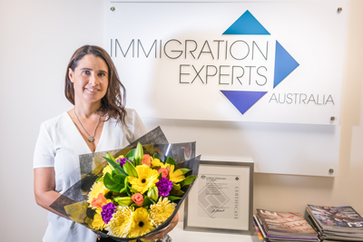 457 Visa Expert, Veronica receiving a corporate gift